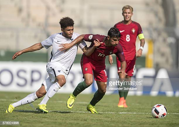 Denis Will Poha of France challenges Joao Carvalho of Portugal during the U19 match between Portugal and France at CarlBenzStadium on July 21 2016 in...