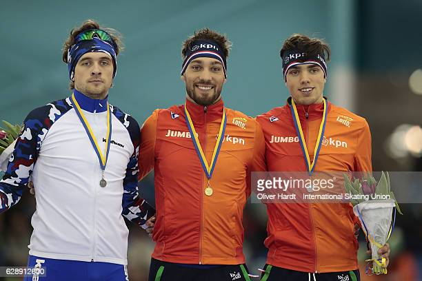 Denis Yuskov of Russia of Russia with the silver medal Kjeld Nuis of Netherlands with the gold medal and Patrick Roest of Netherlands with the bronze...