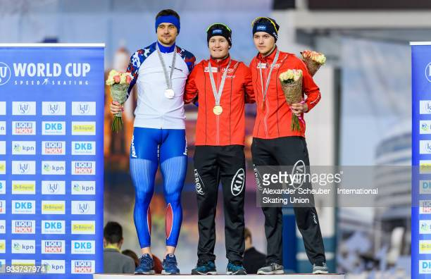 Denis Yuskov of Russia Sverre Lunde Pedersen of Norway and Allan Dahl Johansson of Norway stand on the podium after the Men's 1500m Final during the...