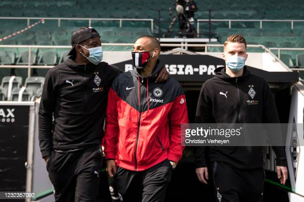 Denis Zakaria and Nico Elvedi of Borussia Moenchengladbach and Djibril Sow of Eintracht Frankfurt are seen before the Bundesliga match between...
