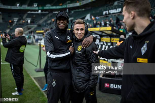 Denis Zakaria and Nico Elvedi of Borussia Moenchengladbach are seen with Thorgan Hazard of Borussia Dortmund before the Bundesliga match between...