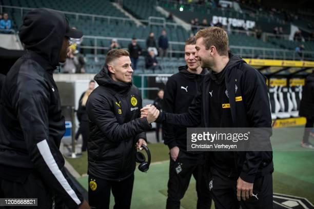 Denis Zakaria Christoph Kramer and Nico Elvedi of Borussia Moenchengladbach are seen with Thorgan Hazard of Borussia Dortmund before the Bundesliga...