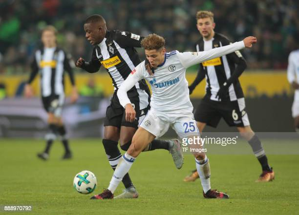 Denis Zakaria of Borussia Moenchengladbach and Amine Harit of Schalke battle for the ball during the Bundesliga match between Borussia...