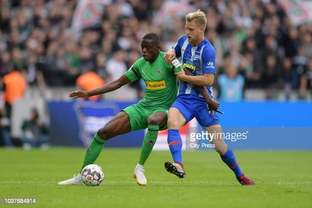 Denis Zakaria of Borussia Moenchengladbach and Arne Maier of Hertha BSC during the game between Hertha BSC and Borussia Moenchengladbach at the...