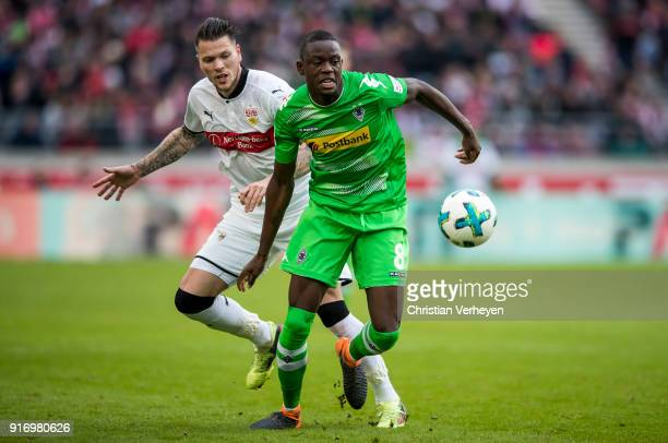 Denis Zakaria of Borussia Moenchengladbach and Daniel Ginczek of VfB Stuttgart in action during the Bundesliga match between VfB Stuttgart and...