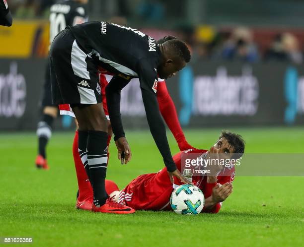 Denis Zakaria of Borussia Moenchengladbach and Javier Martinez of Bayern Muenchen looks on during the Bundesliga match between Borussia...