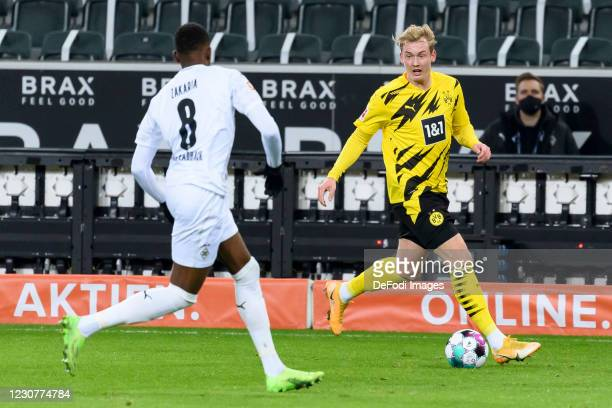 Denis Zakaria of Borussia Moenchengladbach and Julian Brandt of Borussia Dortmund battle for the ball during the Bundesliga match between Borussia...