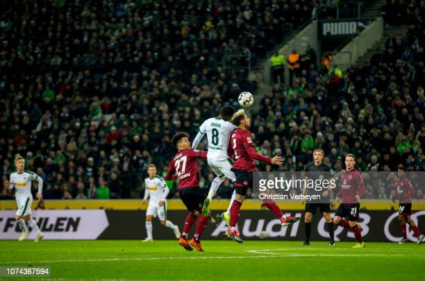 Denis Zakaria of Borussia Moenchengladbach and Kevin Goden of 1FC Nuernberg battle for the ball during the Bundesliga match between Borussia...