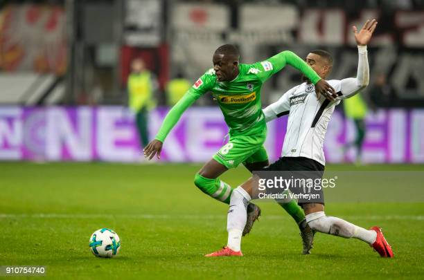 Denis Zakaria of Borussia Moenchengladbach and KevinPrince Boateng of Eintracht Frankfurt battle for the ball during the Bundesliga match between...