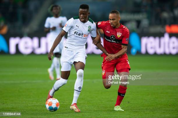 Denis Zakaria of Borussia Moenchengladbach and Nikolas Nartey of VfB Stuttgart battle for the ball during the Bundesliga match between Borussia...