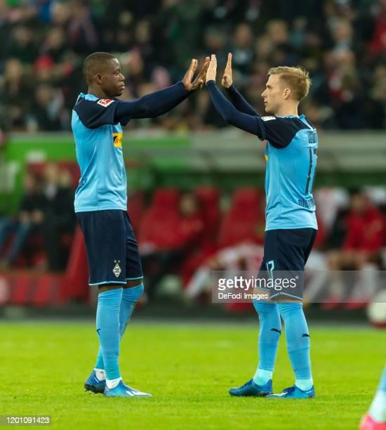 Denis Zakaria of Borussia Moenchengladbach and Oscar Wendt of Borussia Moenchengladbach celebrate after winning the Bundesliga match between Fortuna...