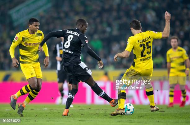 Denis Zakaria of Borussia Moenchengladbach and Sokratis of Borussia Dortmund battle for the ball during the Bundesliga match between Borussia...
