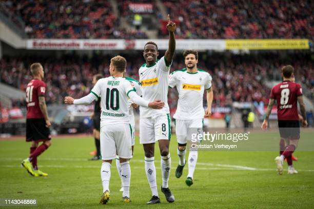 Denis Zakaria of Borussia Moenchengladbach celebrate his team fourth goal with Thorgan Hazard during the Bundesliga match between 1.FC Nuernberg and...