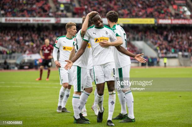 Denis Zakaria of Borussia Moenchengladbach celebrate with his team mates his teams fourth goal during the Bundesliga match between 1.FC Nuernberg and...