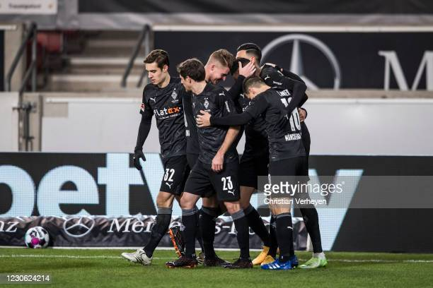Denis Zakaria of Borussia Moenchengladbach celebrate with team mates after he score his teams second goal during the Bundesliga match between VfB...