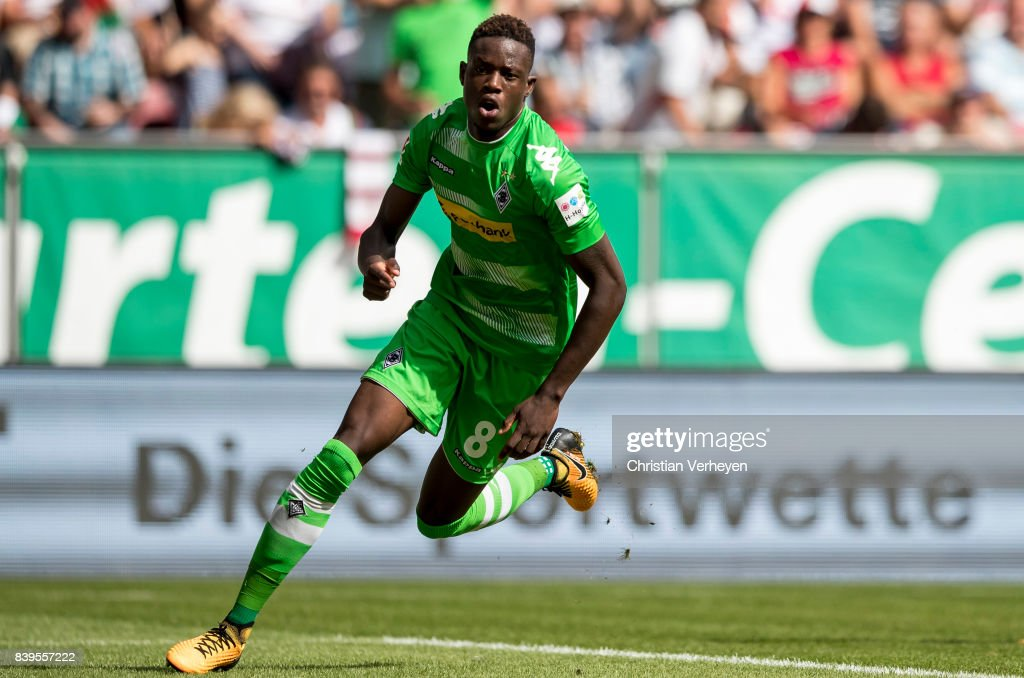 Denis Zakaria of Borussia Moenchengladbach celebrates after he scores his teams first goal during a Bundesliga match between FC Augsburg and Borussia Moenchengladbach at WWK Arena on August 26, 2017 in Moenchengladbach, Germany.
