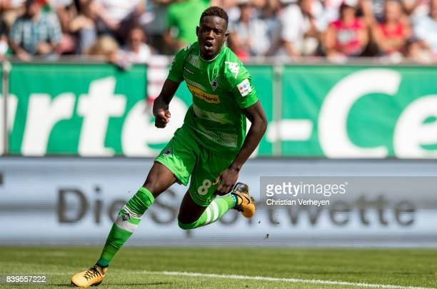 Denis Zakaria of Borussia Moenchengladbach celebrates after he scores his teams first goal during a Bundesliga match between FC Augsburg and Borussia...