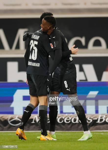 Denis Zakaria of Borussia Moenchengladbach celebrates with team mate Ramy Bensebaini after scoring their side's second goal past Gregor Kobel of VfB...