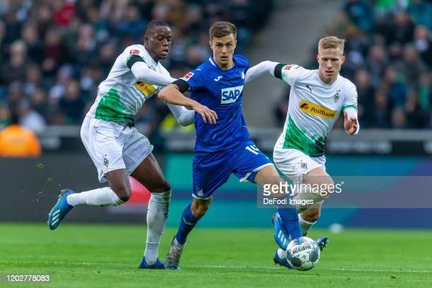 Denis Zakaria of Borussia Moenchengladbach Christoph Baumgartner of TSG Hoffenheim and Oscar Wendt of Borussia Moenchengladbach battle for the ball...