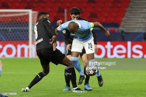 Denis Zakaria of Borussia Moenchengladbach, Fernandinho of Manchester City and Lars Stindl of Borussia Moenchengladbach battle for the ball during...
