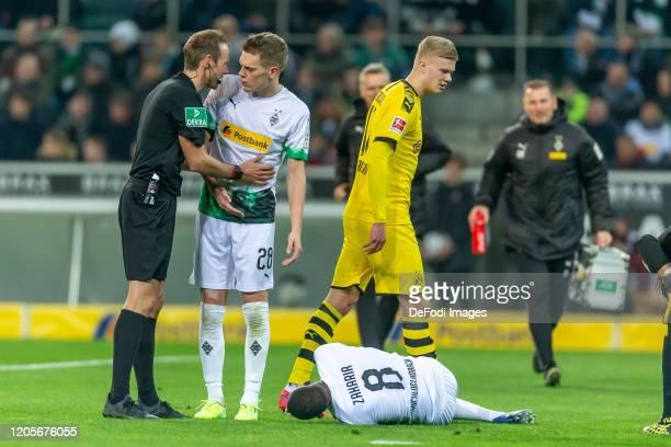 Denis Zakaria of Borussia Moenchengladbach injured during the Bundesliga match between Borussia Moenchengladbach and Borussia Dortmund at...