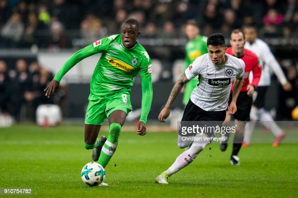 Denis Zakaria of Borussia Moenchengladbach is chased by Carlos Salcedo of Eintracht Frankfurt during the Bundesliga match between Eintracht Frankfurt...