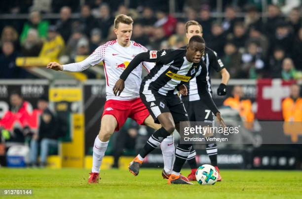Denis Zakaria of Borussia Moenchengladbach is chased by Lukas Klostermann of RB Leipzig during the Bundesliga match between Borussia Moenchengladbach...