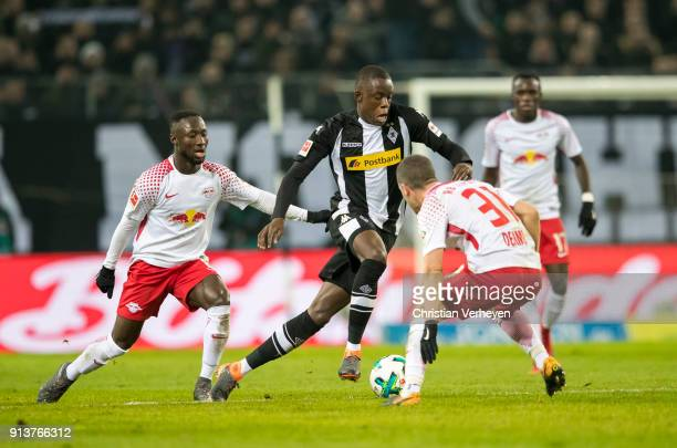 Denis Zakaria of Borussia Moenchengladbach Naby Keita and Diego Demme of RB Leipzig battle for the ball during the Bundesliga match between Borussia...