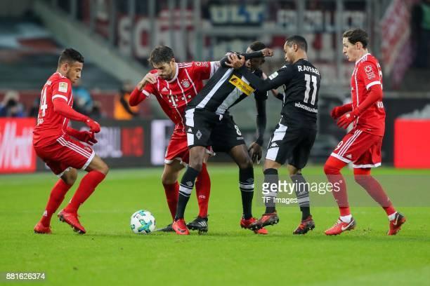 Denis Zakaria of Borussia Moenchengladbach Raffael of Borussia Moenchengladbach and Corentin Tolisso of Bayern Muenchen Javier Martinez of Bayern...