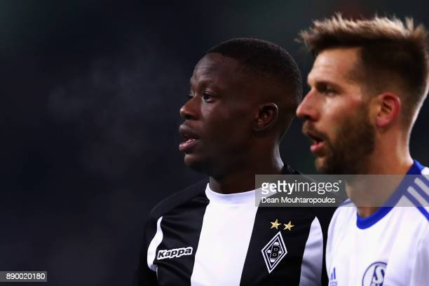 Denis Zakaria of Borussia Monchengladbach and Guido Burgstaller of Schalke 04 look on during the Bundesliga match between Borussia Moenchengladbach...