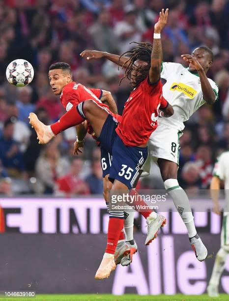 Denis Zakaria of Borussia Monchengladbach and Thiago Alcantara and Renato Sanches of Bayern Munich battle for possession during the Bundesliga match...