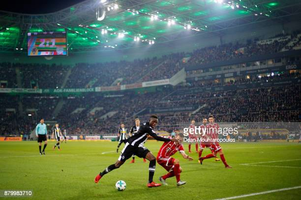 Denis Zakaria of Borussia Monchengladbach battles for the ball with Joshua Kimmich of Bayern Munich during the Bundesliga match between Borussia...