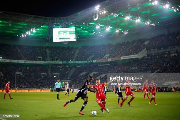 Denis Zakaria of Borussia Monchengladbach battles for the ball with Joshua Kimmich of Bayern Munich during the Bundesliga match between Borussia...