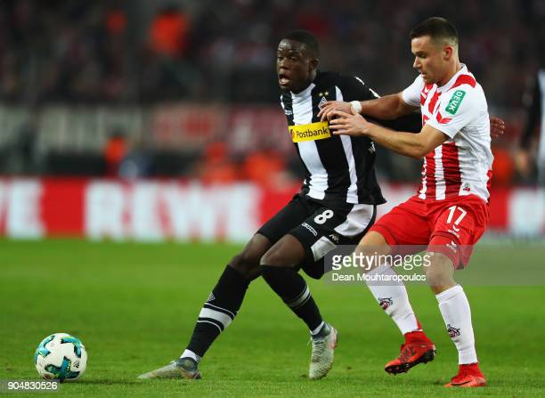 Denis Zakaria of Borussia Monchengladbach battles for the ball with Christian Clemens of FC Koeln during the Bundesliga match between 1 FC Koeln and...
