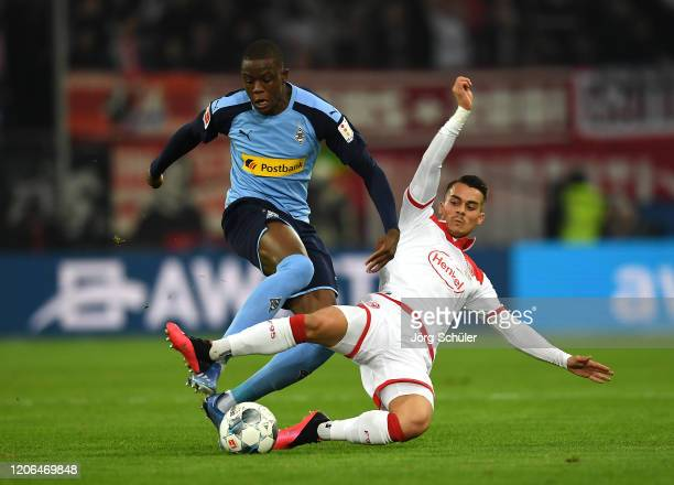 Denis Zakaria of Borussia Monchengladbach is challenged by Erik Thommy of Fortuna Dusseldorf during the Bundesliga match between Fortuna Duesseldorf...