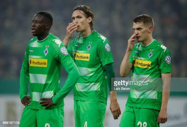 Denis Zakaria of Moenchegladbach Jannik Vestergaard of Moenchengladbach and Matthias Ginter of Moenchengladbach are looking dejected during the DFB...