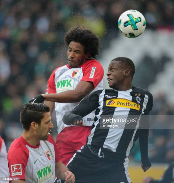 Denis Zakaria of Moenchengladbach and Caiuby of Augsburg battle for the ball during the Bundesliga match between Borussia Moenchengladbach and FC...