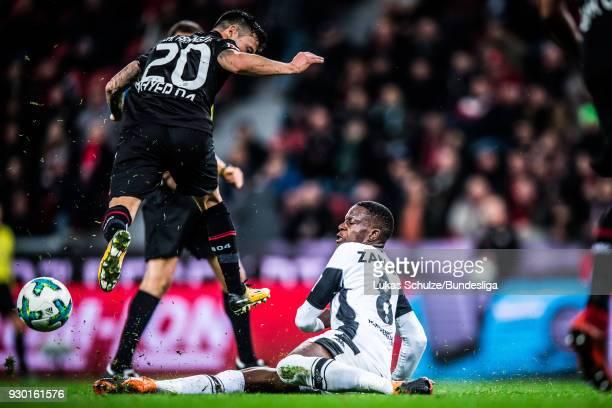 Denis Zakaria of Moenchengladbach and Charles Aranguiz of Leverkusen in action during the Bundesliga match between Bayer 04 Leverkusen and Borussia...