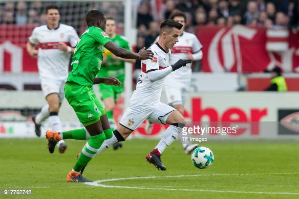 Denis Zakaria of Moenchengladbach and Erik Thommy of Stuttgart battle for the ball during the Bundesliga match between VfB Stuttgart and Borussia...
