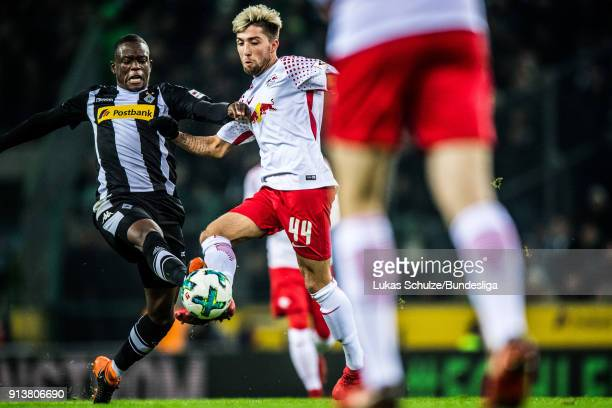 Denis Zakaria of Moenchengladbach and Kevin Kampl of Leipzig in action during the Bundesliga match between Borussia Moenchengladbach and RB Leipzig...