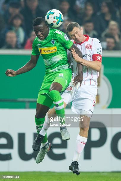 Denis Zakaria of Moenchengladbach and Oliver Fink of Duesseldorf head the ball during the DFB Cup match between Fortuna Duesseldorf and Borussia...