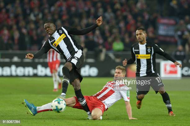 Denis Zakaria of Moenchengladbach and Simon Terodde of Koeln battle for the ball during the Bundesliga match between 1 FC Koeln and Borussia...