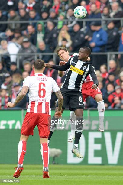 Denis Zakaria of Moenchengladbach and Simon Zoller of Koeln battle for the ball during the Bundesliga match between 1 FC Koeln and Borussia...