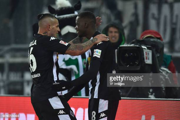 Denis Zakaria of Moenchengladbach celebrates after scoring his team`s first goal with Raul Bobadilla of Moenchengladbach during the Bundesliga match...