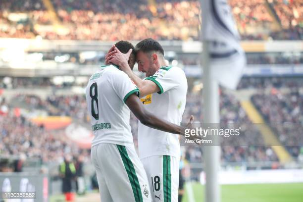Denis Zakaria of Moenchengladbach celebrates his team's first goal with team mate Josip Drmic during the Bundesliga match between Eintracht Frankfurt...