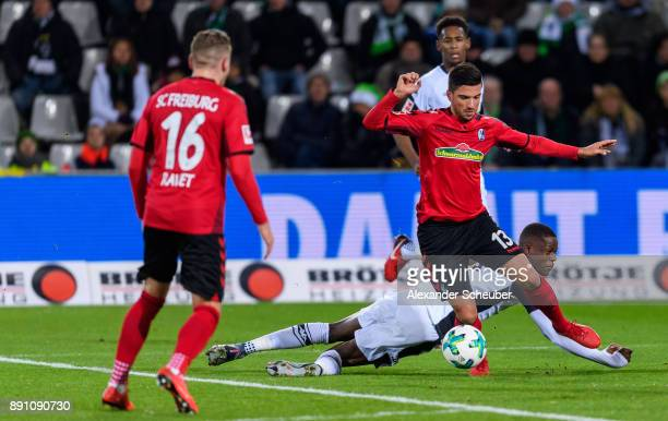 Denis Zakaria of Moenchengladbach challenges Marco Terrazzino of Freiburg during the Bundesliga match between SportClub Freiburg and Borussia...