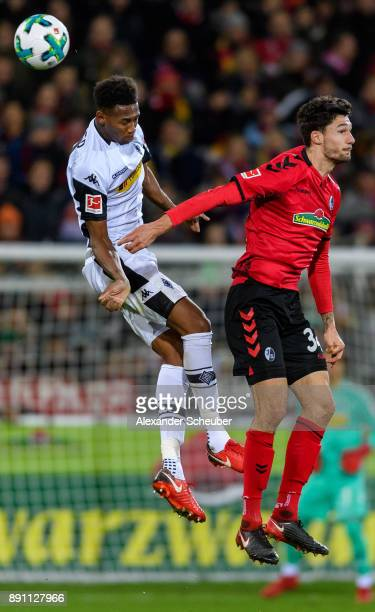 Denis Zakaria of Moenchengladbach challenges Tim Kleindienst of Freiburg during the Bundesliga match between SportClub Freiburg and Borussia...
