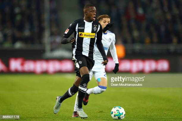 Denis Zakaria of Moenchengladbach fights for the ball with Matija Nastasic of Schalke during the Bundesliga match between Borussia Moenchengladbach...