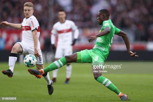 Denis Zakaria of Moenchengladbach is challenged by Santiago Ascacibar of Stuttgart during the Bundesliga match between VfB Stuttgart and Borussia...