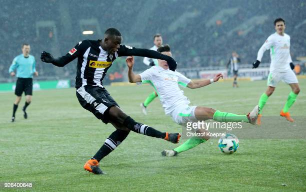 Denis Zakaria of Moenchengladbach scores the second goal against Marco Friedl of Bremen during the Bundesliga match between Borussia Moenchengladbach...